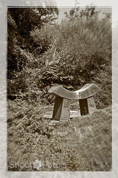 Stone bench at Abkhazi Garden. Sepia version.