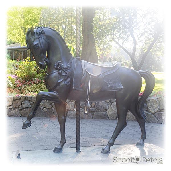 Metal Horse Near the Rose Carousel