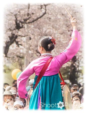 South Korean traditional woman drummer.