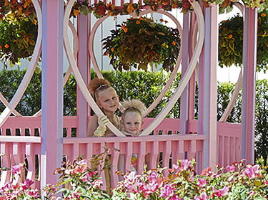 Minnie Mouse's garden has pink flowers and a pink gazebo