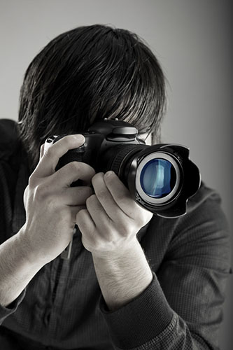Photographer Hand-Holding His Camera