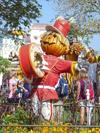 Parade at the Magical Kingdom - scarecrow and yellow fall flowers.