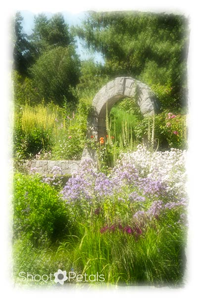 Stone arch north of Formal Rose Garden at VanDusesn Botanical Garden