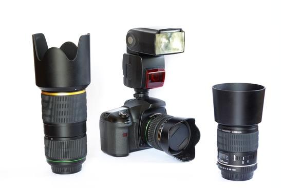 SLR camera body, lenses and flash unit.